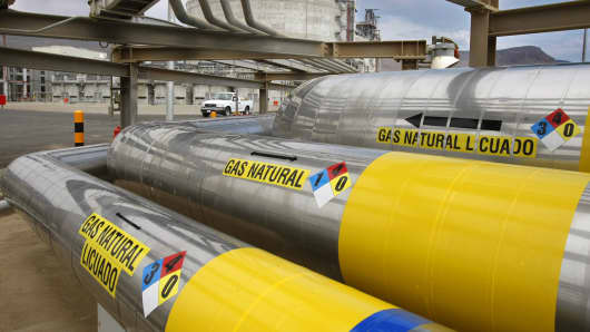 A network of insulated pipes carry liquefied natural gas from ships to giant storage tanks at Sempra Energy's Costa Azul terminal north of Ensenada, Mexico.