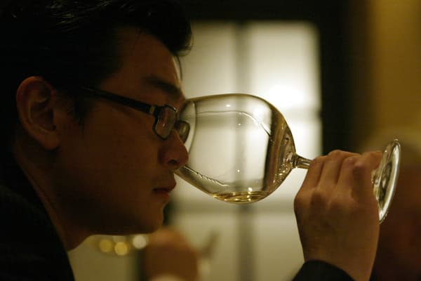 Wine collector Rudy Kurniawan, of Arcadia, wine tasting. Photo to illustrate a column about Pierre Henry Gagey, CEO of Maison Louis Jadot in France, about his wines and about a dinner at Campanile restaurant, where several wine collectors were tasting his wines dating back to 1959.