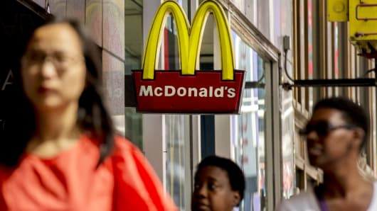 Pedestrians walk by a McDonald's location in New York.