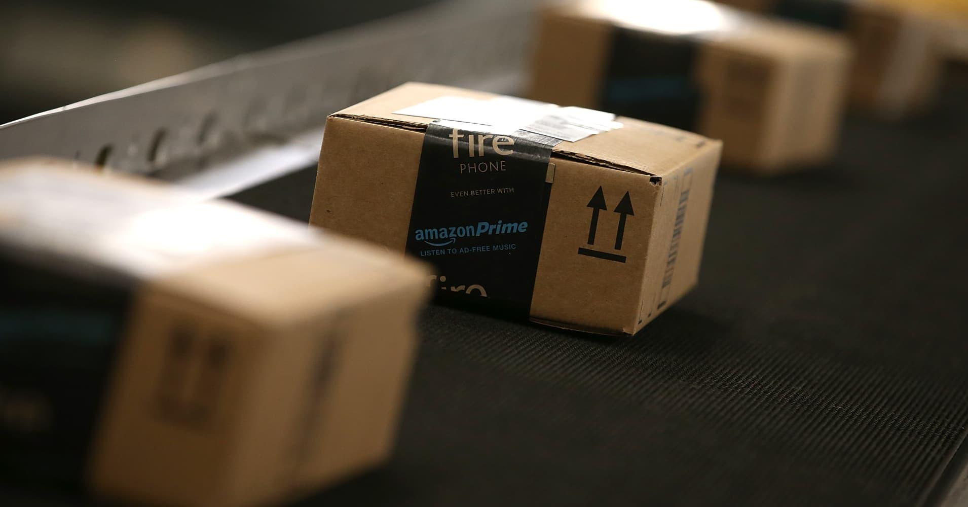 Boxes move along a conveyor belt at an Amazon fulfillment center in Tracy, California.