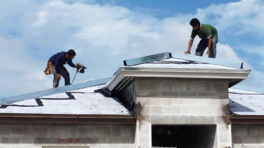 Construction workers building a new home in Miami, Florida.