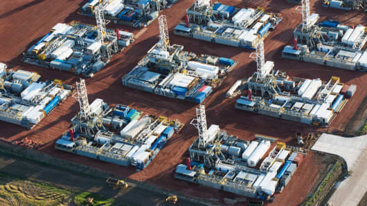 Stacked rigs are seen along with other idled oil drilling equipment in Dickinson, North Dakota, June 26, 2015.