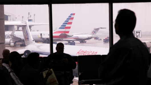 American Airlines planes and passengers at the Dallas/Fort Worth International Airport.