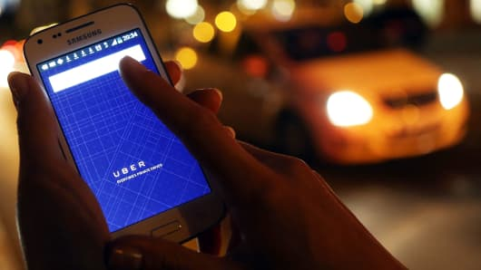 Woman using Uber app