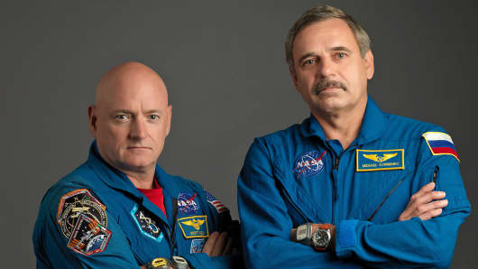 NASA astronaut Scott Kelly, left, and Russian cosmonaut Mikhail Kornienko take a break from training at NASA's Johnson Space Center to pose for a portrait.