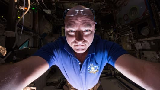 NASA astronaut Scott Kelly on the International Space Station prepares another scientific experiment.