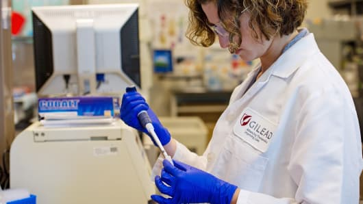 A scientist at Gilead Sciences analyzes patient antibody levels at the Gilead laboratory in Foster City, Calif.