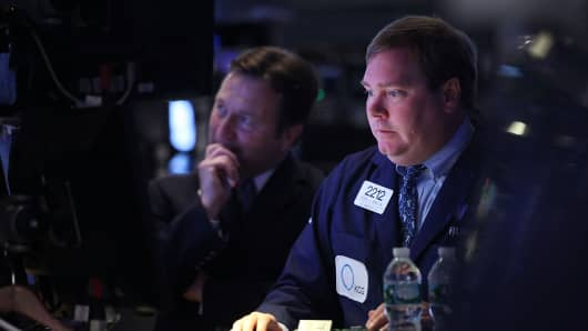 Traders work on the floor of the New York Stock Exchange (NYSE) on July 27, 2015 in New York City.