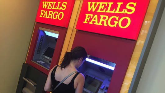 A woman uses a Wells Fargo ATM in New York City.