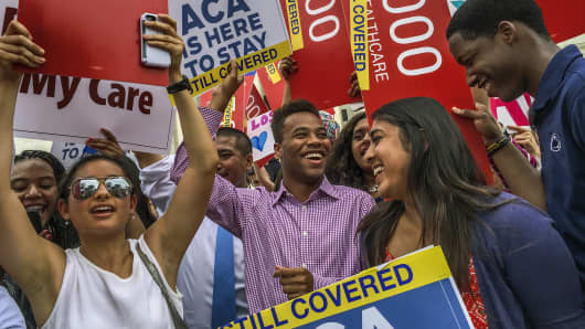 Students from around the country celebrate in front of the Supreme Court after justices decide for the Affordable Care Act, on June, 25, 2015, in Washington, D.C.
