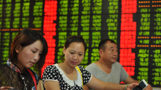 Investors observe electric screen at a stock exchange hall on July 28, 2015, in Fuyang, China.