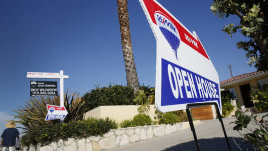 RE/MAX Holdings signage is displayed outside an open house in Redondo Beach, California.