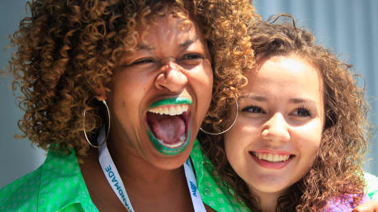 GloZell Green, left, poses for a photo with a fan at VidCon at the Anaheim Convention Center, July 23, 2015.