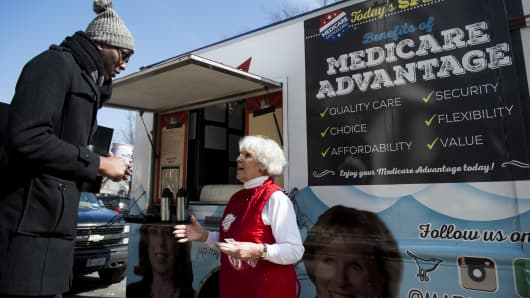 Carol Berman, of West Palm Beach, Fla., speaks with pedestrians about the need for policymakers to protect Medicare Advantage benefits during the Coalition for Medicare Choices' Medicare Advantage Food Truck stop on North Capitol Street in Washington on Monday, March 9, 2015.
