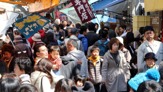 Shoppers visit a food market in Tokyo