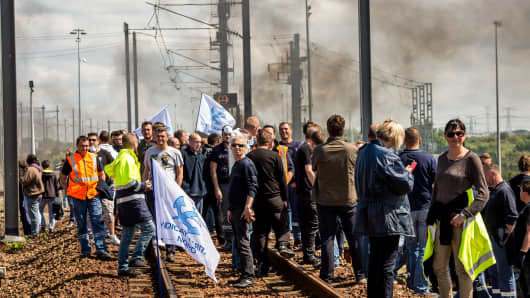 Protesting French employees block the railway tracks of the Eurostar Channel tunnel line on June 23, 2015 in Calais, France.
