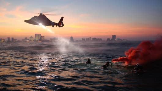 U.S. Coast Guard rescue swimmers at work.