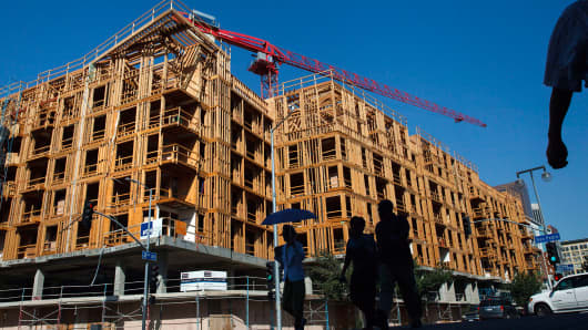 Workers build an apartment building at a construction site in downtown Los Angeles.