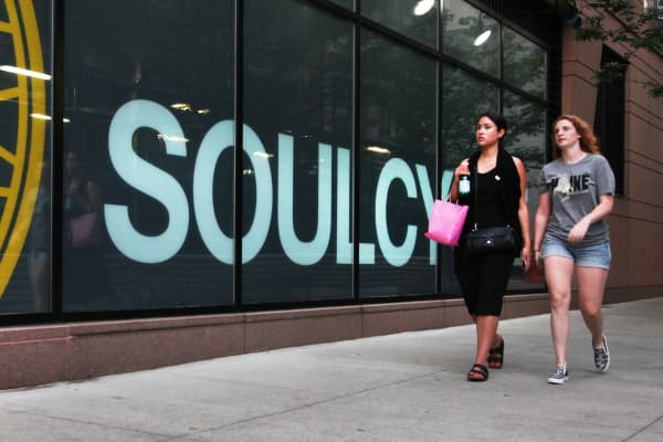 Pedestrians pass a SoulCycle location in New York.