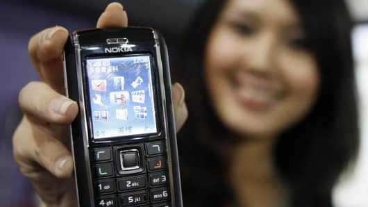 A model displays the Nokia 6151, at the Nokia exhibition in Singapore, June 19, 2006.