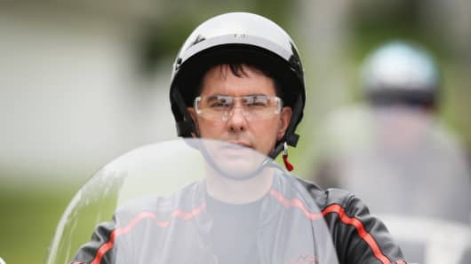 Wisconsin Governor Scott Walker rides a motorcycle near Boone, Iowa in June.