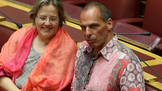Greek Former Finance Minister Yanis Varoufakis and former Deputy Finance Minister Nadia Valavani attend the Prime Minister's Questions at parliament in Athens, Greece July 31, 2015.