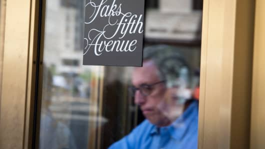 A shopper exits Saks Fifth Avenue in New York.