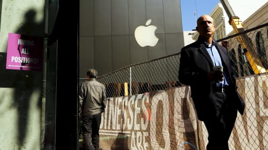 A pedestrian passes an Apple store in San Francisco.