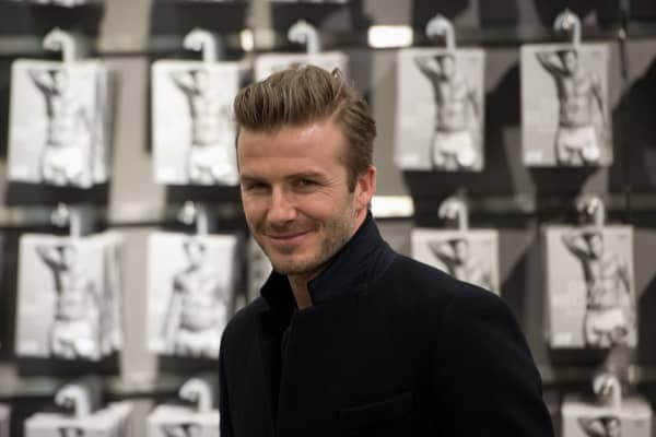 British footballer David Beckham poses on March 19, 2013 during a commercial assignment at H&M store in Berlin.