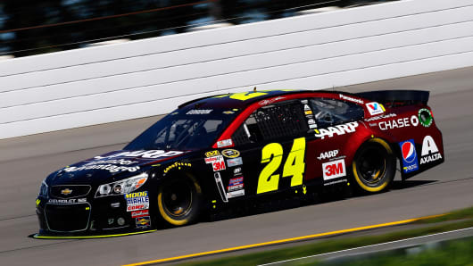 Jeff Gordon, driver of the #24 AARP Member Advantages Chevrolet, at the Pocono Raceway in Long Pond, Pennsylvania.