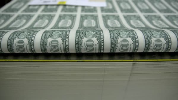 50 subject one dollar note sheets sit in a stack before receiving a serial number and the U.S. Treasury and U.S. Federal Reserve seals at the U.S. Bureau of Engraving and Printing in Washington, D.C.