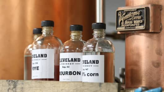Spirits distilled by Cleveland Whiskey, a small business that uses pressure aging technology to produce its batches in a fraction of the time required by distillers using traditional methods.