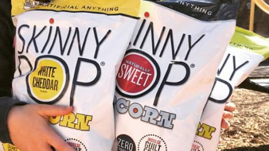 Skinny Pop popcorn by Amplify Snack Brands