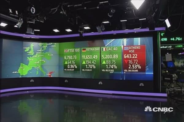 European markets end higher; earnings dominate