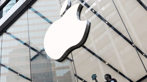 An employee cleans a window at Apple Inc.'s new Canton Road store in the Tsim Sha Tsui district of Hong Kong, China.