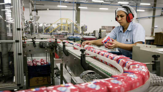 A worker does a quality control check at the Kimberly-Clark manufacturing facility in Camacari, Brazil.