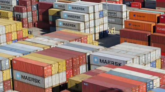 Shipping containers are stacked at the Port of Long Beach, Calif.