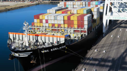 A cargo ship is loaded with shipping containers at the Port of Long Beach, Calif.