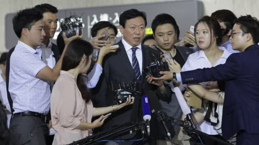 Shin Dong-Bin speaks with the media in Seoul on August 3, 2015