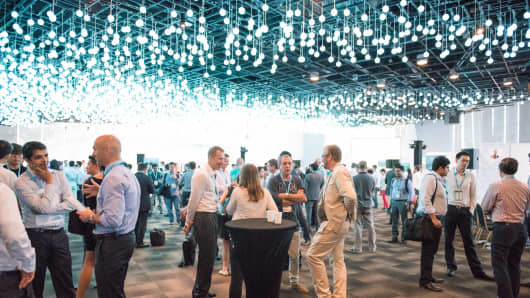 Investors and startup founders mingle at the Startupbootcamp FinTech Demo Day in Singapore.
