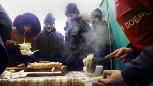Homeless people wait for a food distribution in Rostov-on-Don, Russia.