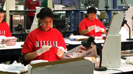 Netflix workers sort DVDs at the company's Piscataway, New Jersey, distribution center.