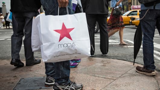 A shopper with a Macy's bag in New York.