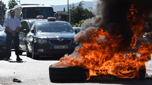 French taxi drivers burn tires as they protest against UberPOP in Marseille in June.