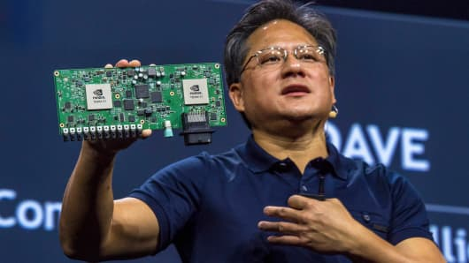 Jen-Hsun Huang, CEO of Nvidia, holds a Nvidia Drive PX Auto-Pilot Computer during the GPU Technology Conference in San Jose, California, last March.