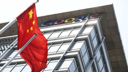 A Chinese flag blows in the wind in front of Google Inc.'s offices in Beijing, China.