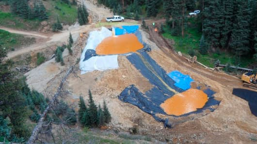 Yellow mine waste water from the Gold King Mine collects in holding pools in San Juan County, Colorado, in this picture released by the Environmental Protection Agency taken August 7, 2015.
