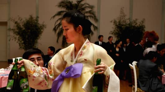 North Korean waitresses distribute beer during a official reception in Pyongyang, North Korea.