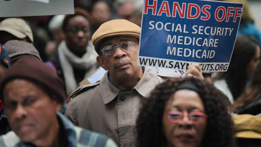 Demonstrators, including many senior citizens, protest against cuts to federal safety net programs, including Social Security, Medicare, and Medicaid in Chicago, Illinois. (file photo)