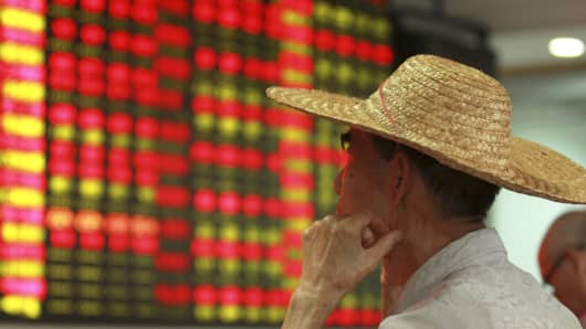 An investor looking at stock prices in Haikou, China, August 11, 2015.
